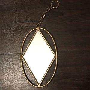 Small hanging geometric mirror